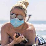200602124058 masked woman beach exlarge 169 1