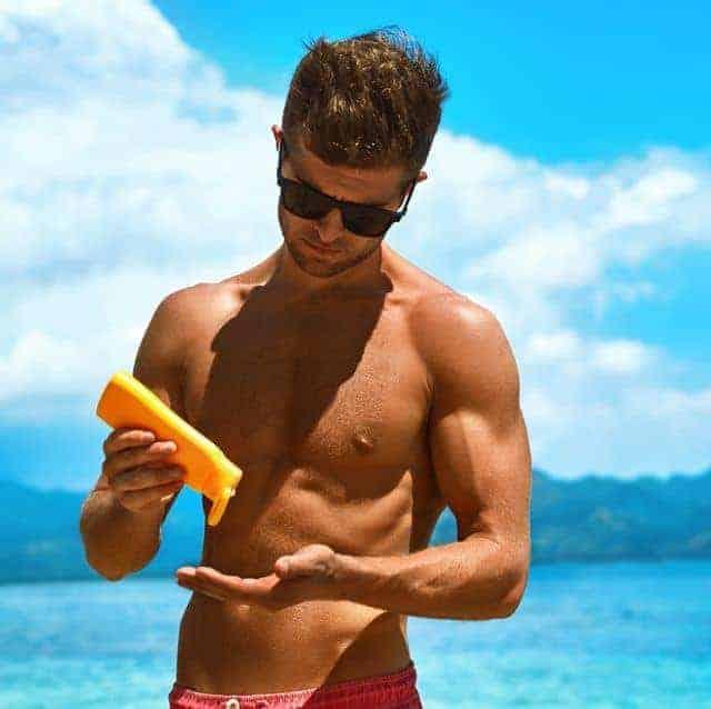 summer skincare man applying sunscreen protection royalty free image 637222044 1565275289