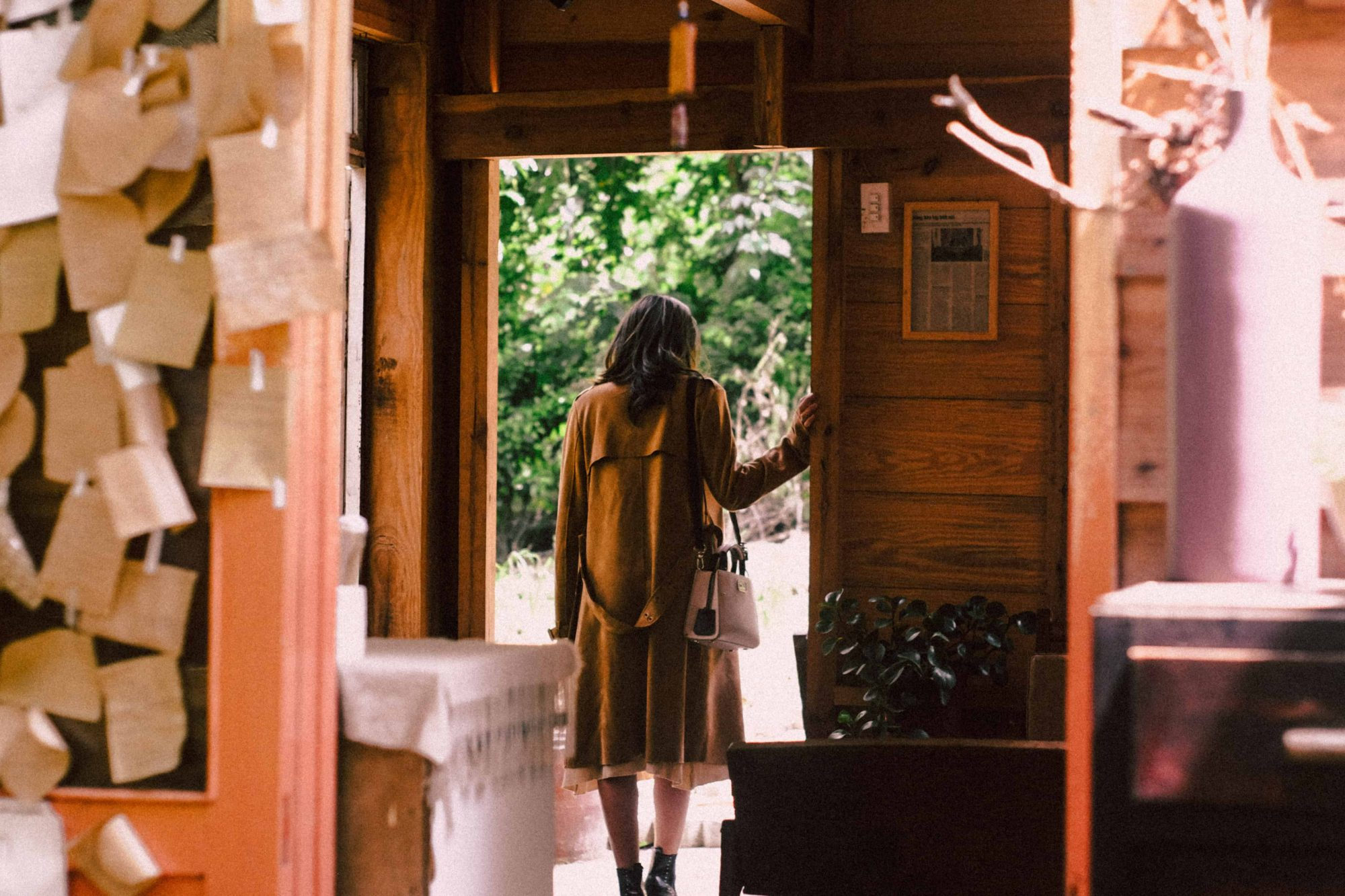 woman standing near open door about to step outside stockpack pexels scaled