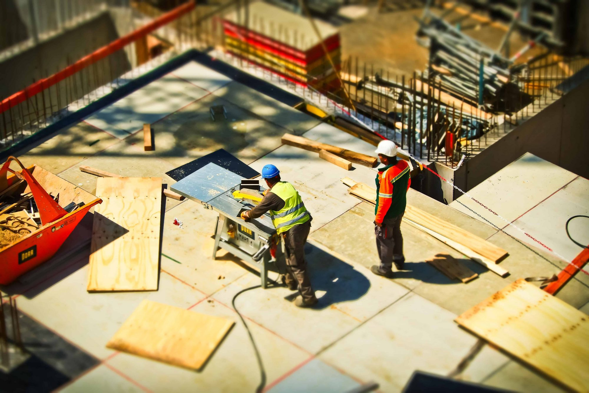 2 man on construction site during daytime stockpack pexels scaled