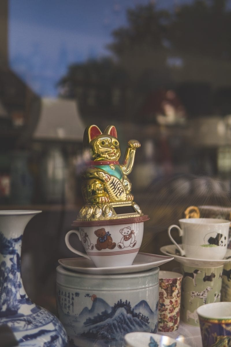 gold and red dragon figurine on white ceramic teacup