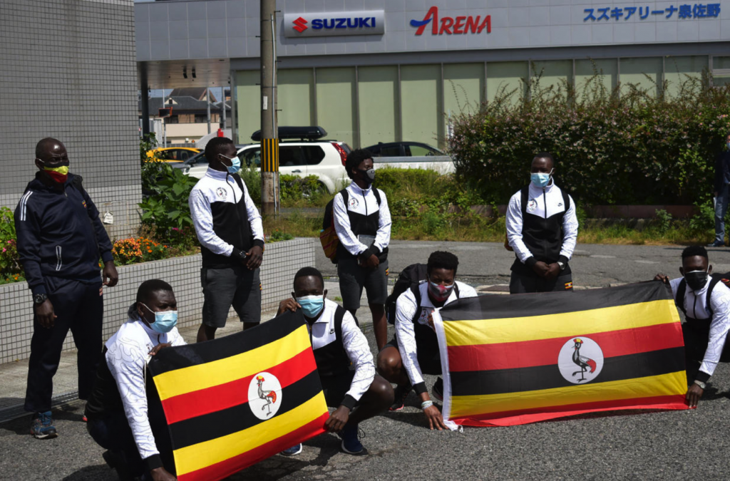 Members of the Uganda Olympics team pose for a photocall as they arrive at a hotel in Izumisano city, Osaka Prefecture on June 20, 2021.